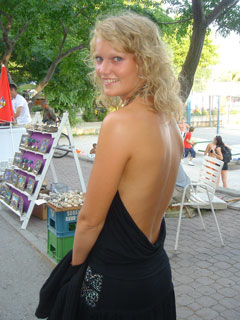 Charming young girl in semi nude dress outdoors